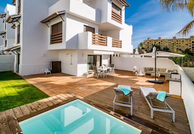 Holiday apartment in Golf hills Estepona. Large terrace with small swimming pool near golf and beach