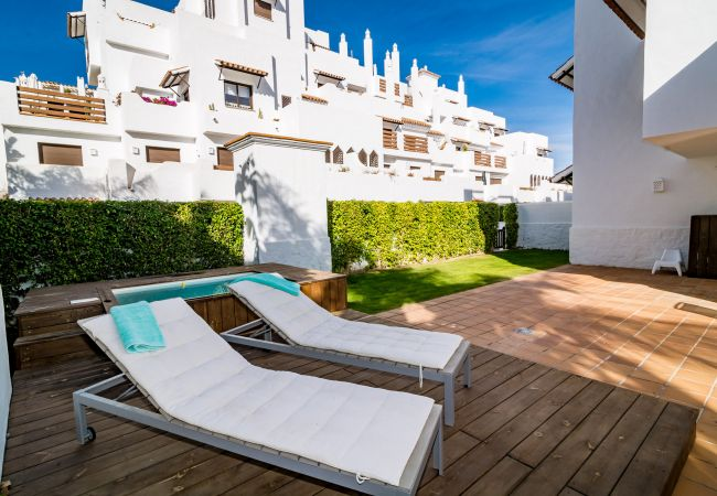 Sunbathing area of 2 Bedroom Holiday Apartment with Pool and terrace in Estepona